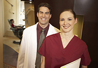 doctor and assistant smiling